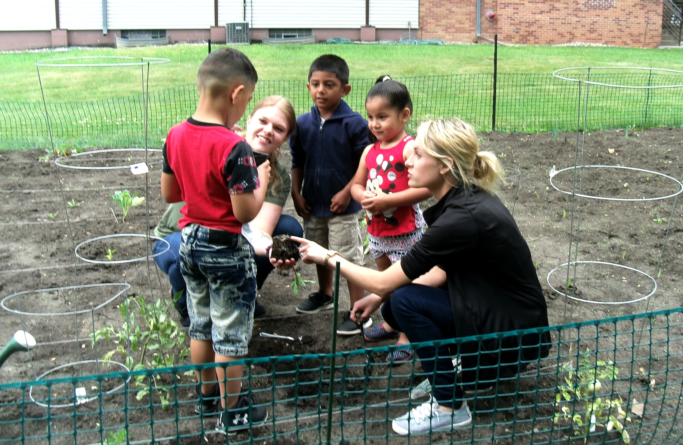 Jami working in the garden with the Head Start kids