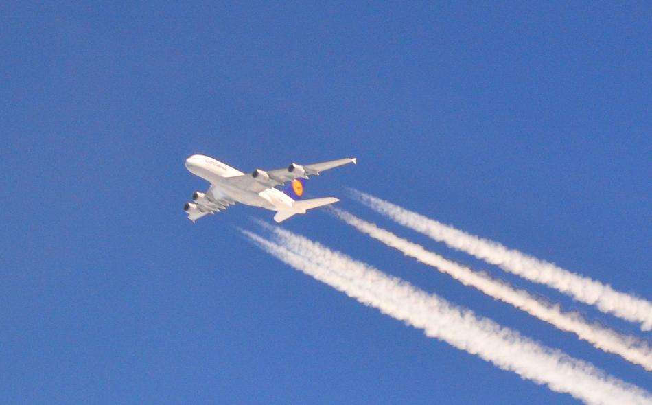 Airplane with big contrail