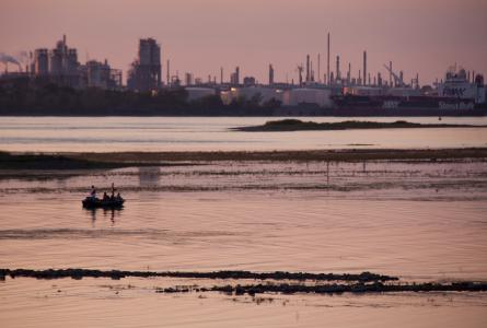 Polluted water next to refinery