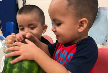 Kids from Tri-Valley Head Start with a watermelon